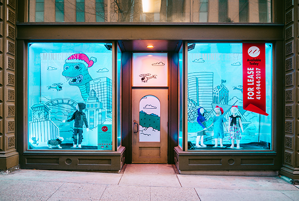 Holiday window display featuring children's apparel retailer, designed by Retailworks Inc.