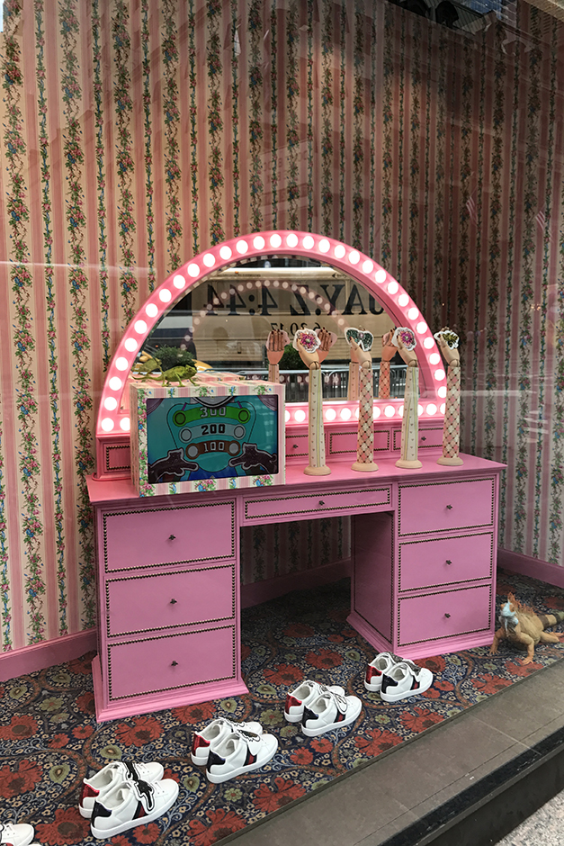 Gucci window display with pink vanity in New York