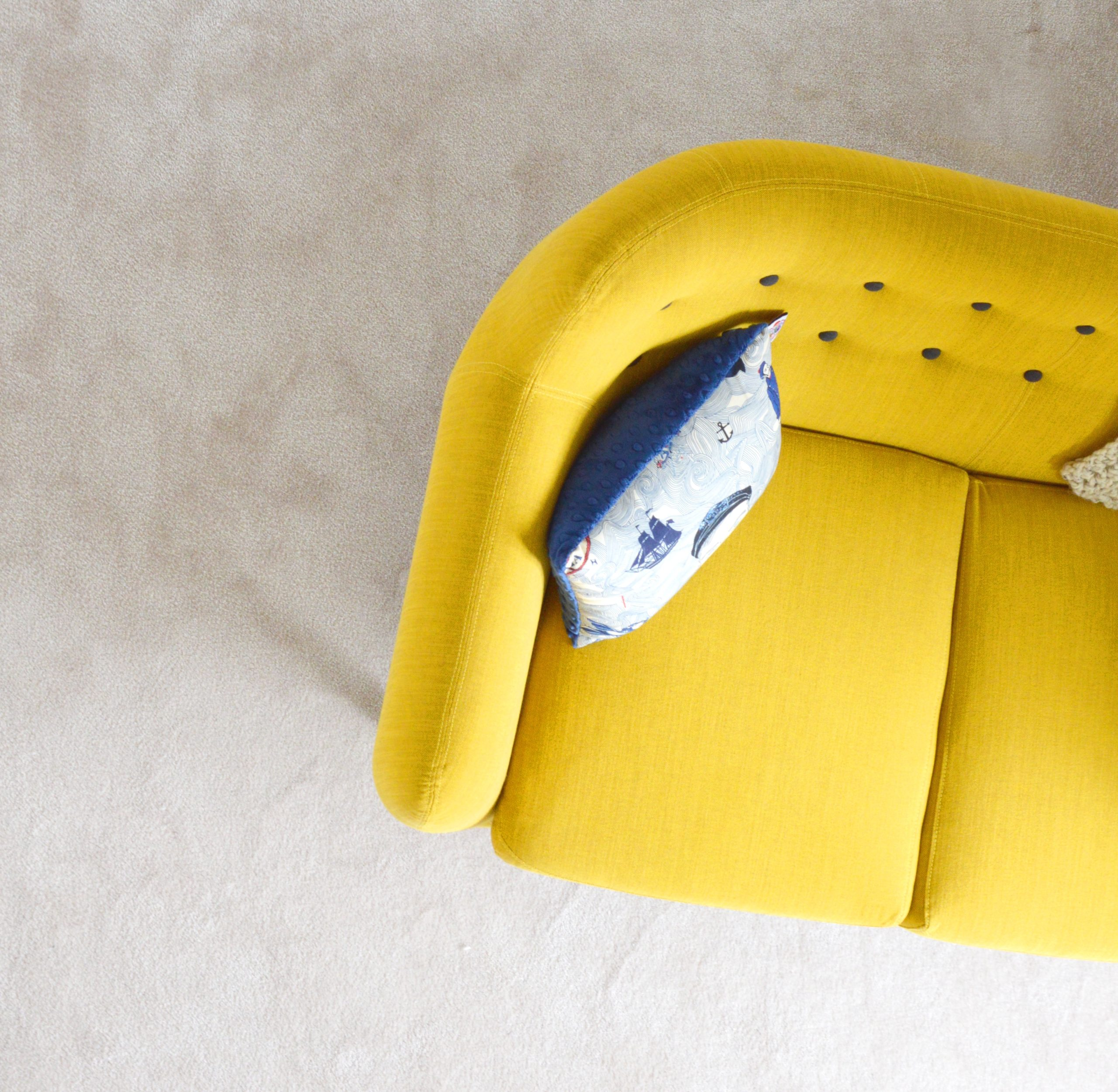Yellow couch with pillow