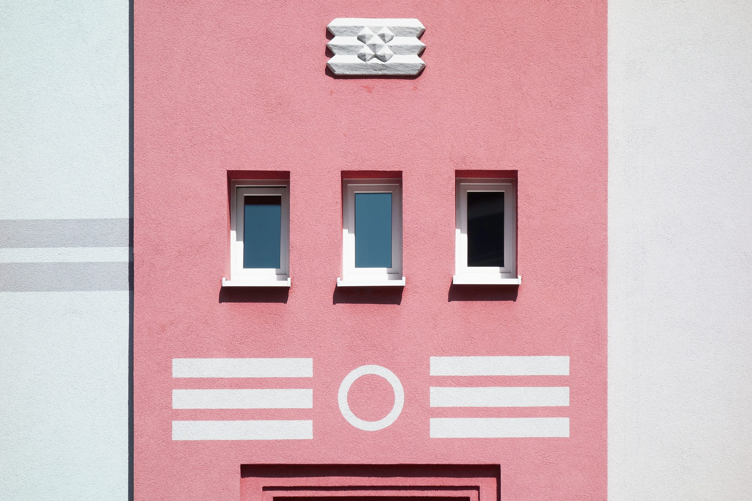 Pink building with white stripes