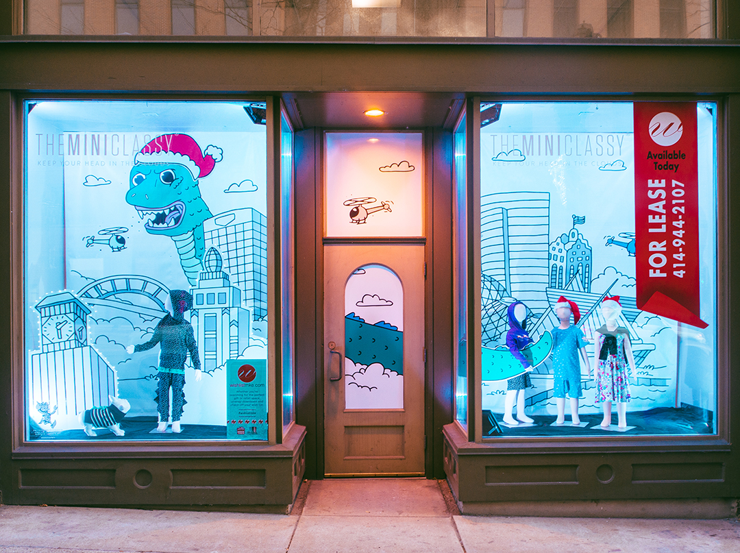 Holiday window display for a Milwaukee children's apparel retailer designed by Retailworks Inc.