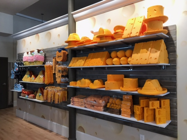 Displays with cheese themed retail products merchandised on the wall at the Dairy Heritage Center in Plymouth, Wisconsin