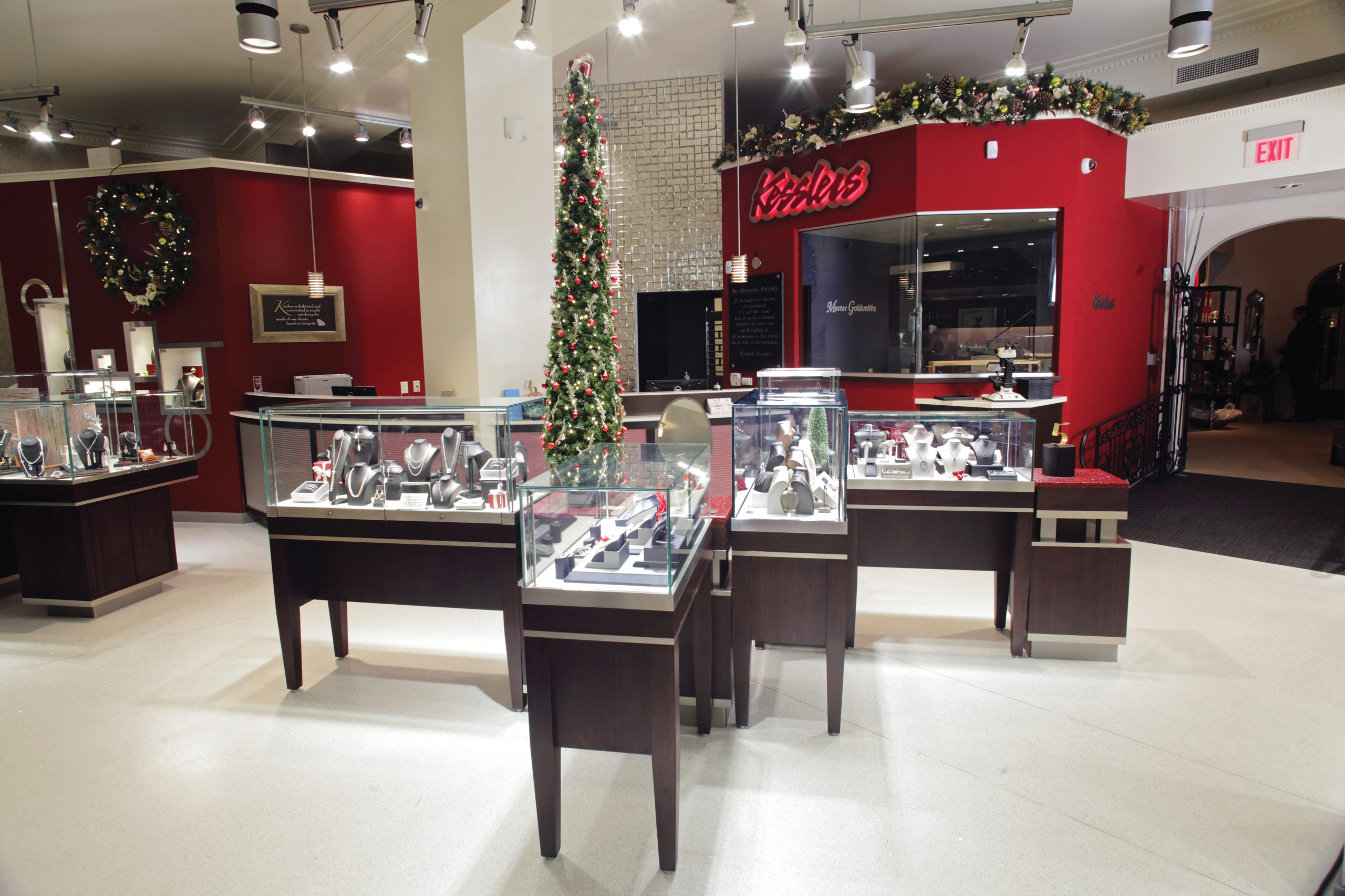 Glass displays cases decorated for the holidays in Kesslers Diamonds